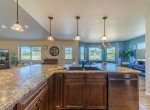 Kitchen Overlooking Dining and Living Rooms - 413 Alta Lakes Ave Montrose, CO - Atha Team Realty