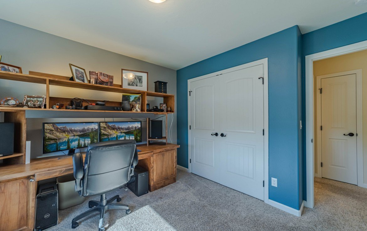 Bedroom with Closet - 413 Alta Lakes Ave Montrose, CO - Atha Team Realty