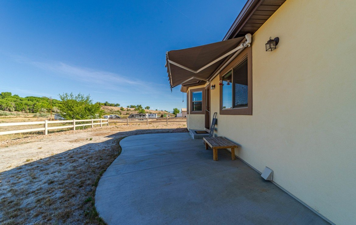 Back Patio with Retractable Awning - 413 Alta Lakes Ave Montrose, CO - Atha Team Realty
