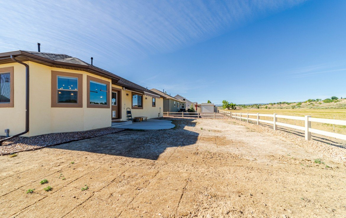Back Yard with Sprinklers - 413 Alta Lakes Ave Montrose, CO - Atha Team Realty