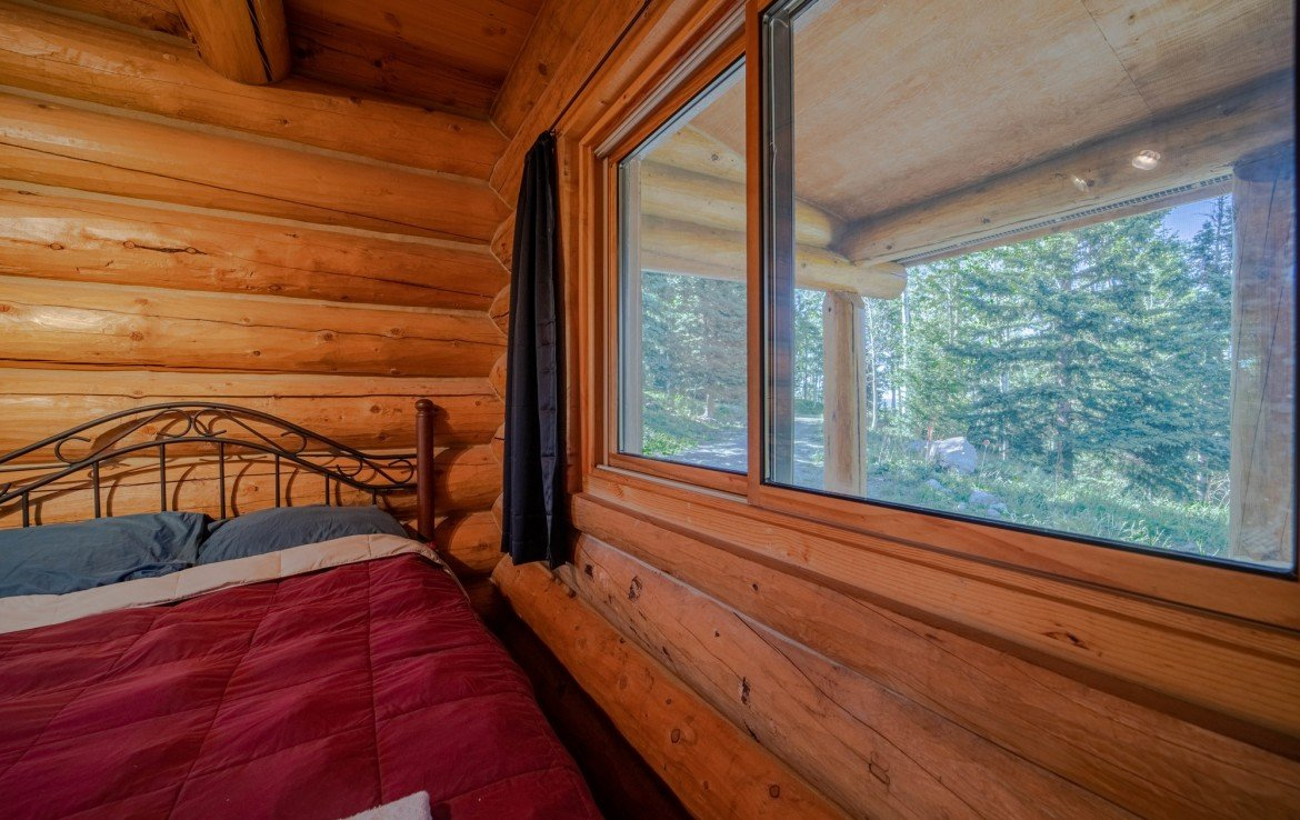 Bedroom with Windows - 84 Columbine Trail Cimarron Colorado 81220 - Atha Team Realty