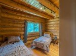 Bedroom with Open Beams - 84 Columbine Trail Cimarron Colorado 81220 - Atha Team Realty