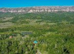 Aerial View of Cabin with Cimarron Mountain Views - 84 Columbine Trail Cimarron Colorado 81220 - Atha Team Realty