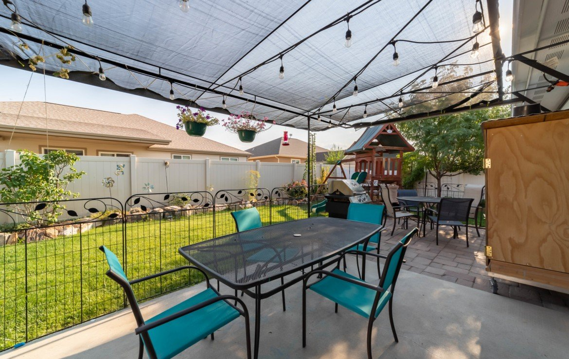 Back Patio Seating Area - 1300 Gold Creek Montrose, CO 81403 - Atha Team Property for Sale