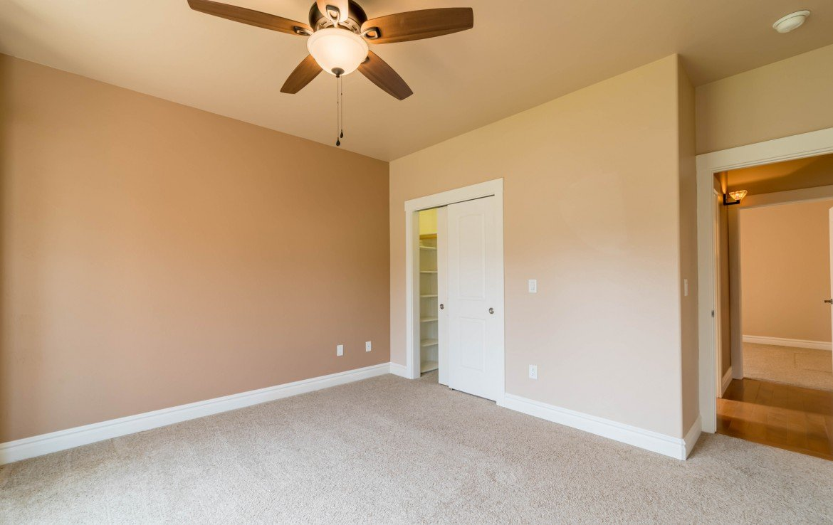 Guest Bedroom with Ceiling Fan and Closet - 641 Badger Ct Montrose, CO 81403 - Atha Team Realty