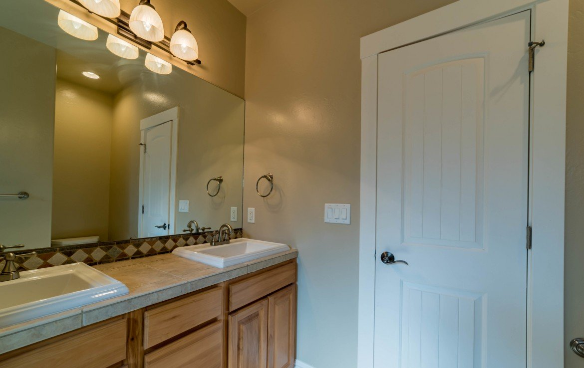 Guest Bathroom with Tile Flooring - 641 Badger Ct Montrose, CO 81403 - Atha Team Realty