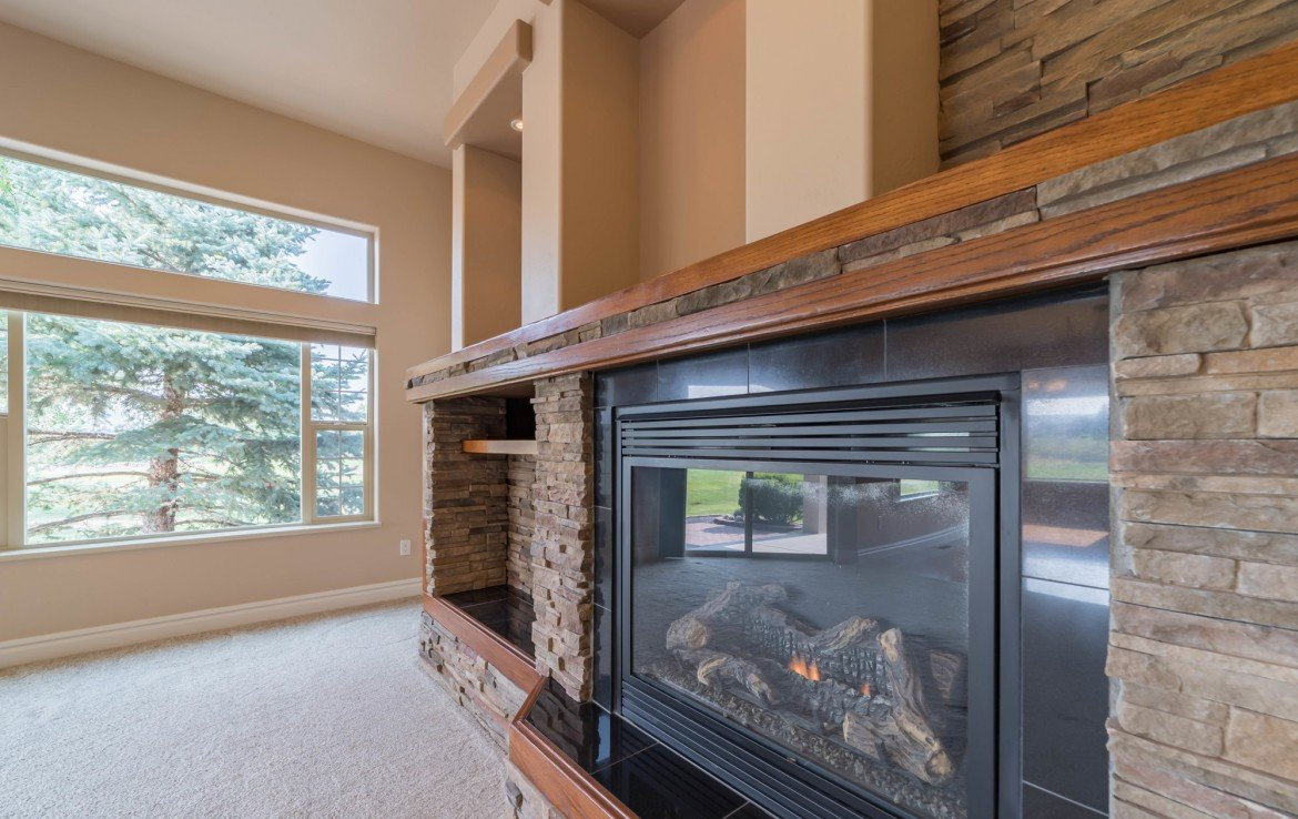 Living Room with Gas Log Fireplace - 641 Badger Ct Montrose, CO 81403 - Atha Team Realty