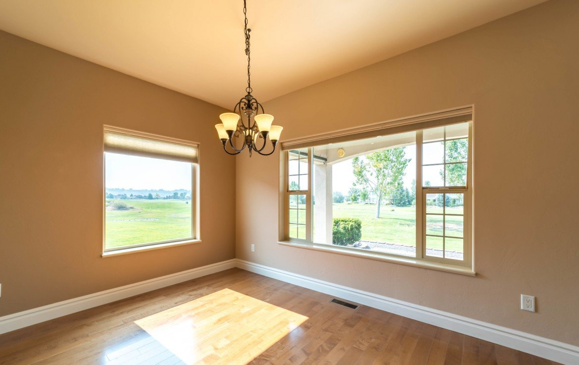 Dining Room with Golf Course Views - 641 Badger Ct Montrose, CO 81403 - Atha Team Realty