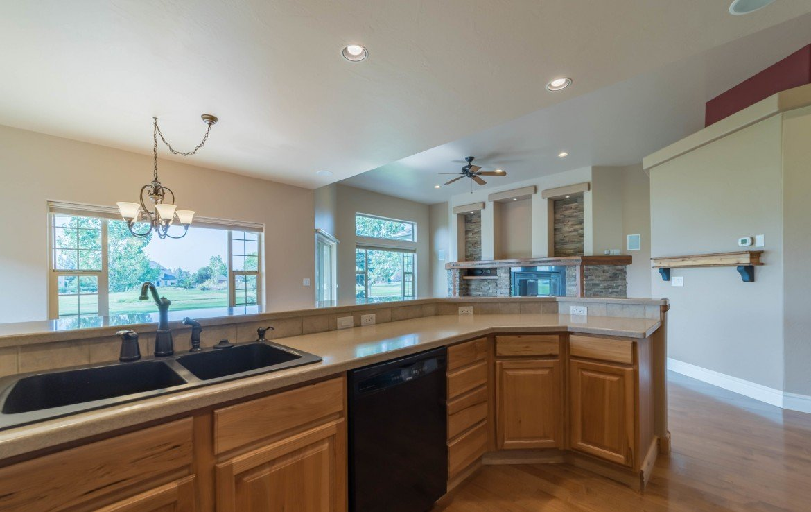 Kitchen with Black Appliances - 641 Badger Ct Montrose, CO 81403 - Atha Team Realty