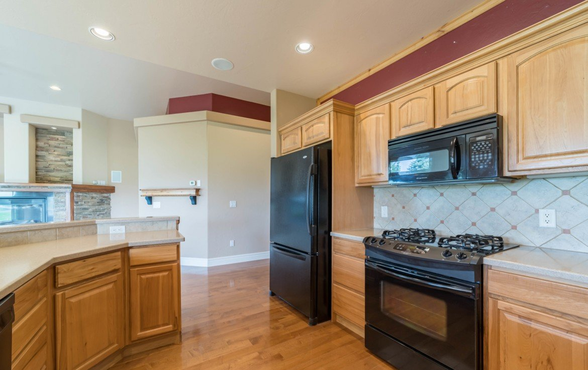 Kitchen with Hardwood Floors - 641 Badger Ct Montrose, CO 81403 - Atha Team Realty