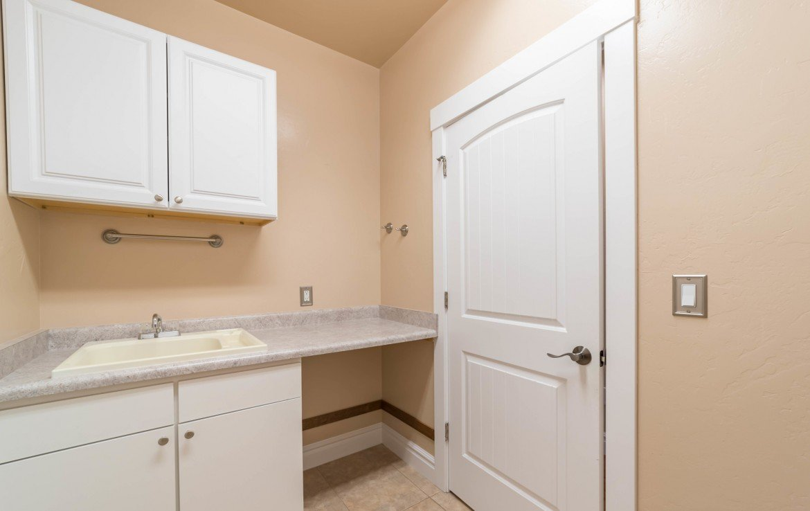 Laundry Room with Sink - 641 Badger Ct Montrose, CO 81403 - Atha Team Realty