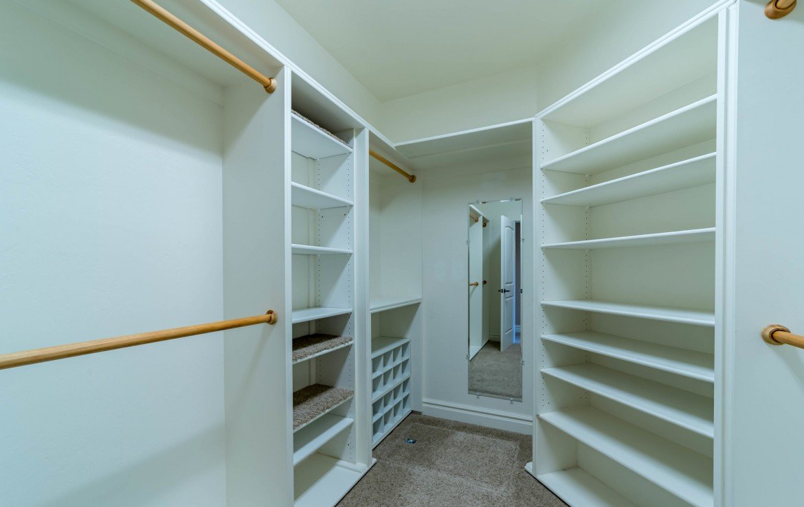 Master Closet with Built Ins - 641 Badger Ct Montrose, CO 81403 - Atha Team Realty