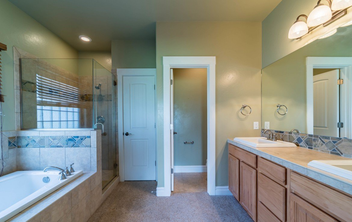 Master Bathroom with Carpet and Tile - 641 Badger Ct Montrose, CO 81403 - Atha Team Realty
