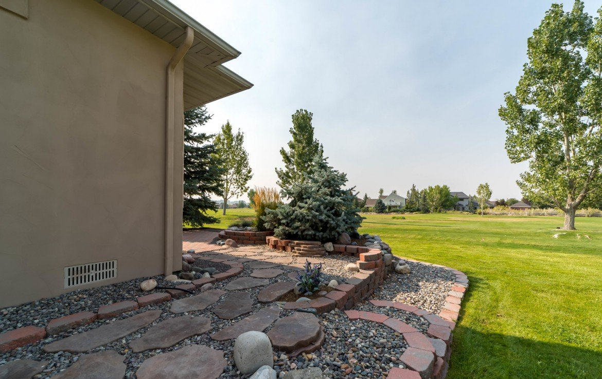 Landscaping Maintenance Included - 641 Badger Ct Montrose, CO 81403 - Atha Team Realty