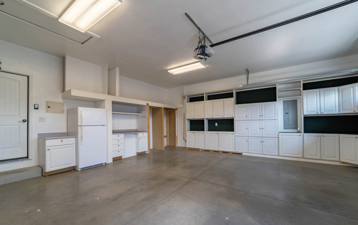 Garage with workspace and cabinets- 641 Badger Ct Montrose, CO 81403 - Atha Team Realty