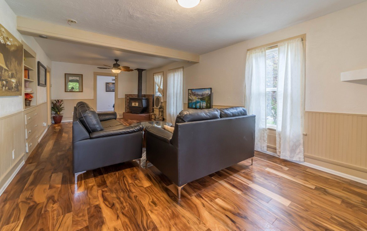 Living Room with Laminate Flooring - 1116 N 1st St Montrose, CO 81401 - Atha Team Real Estate Agents