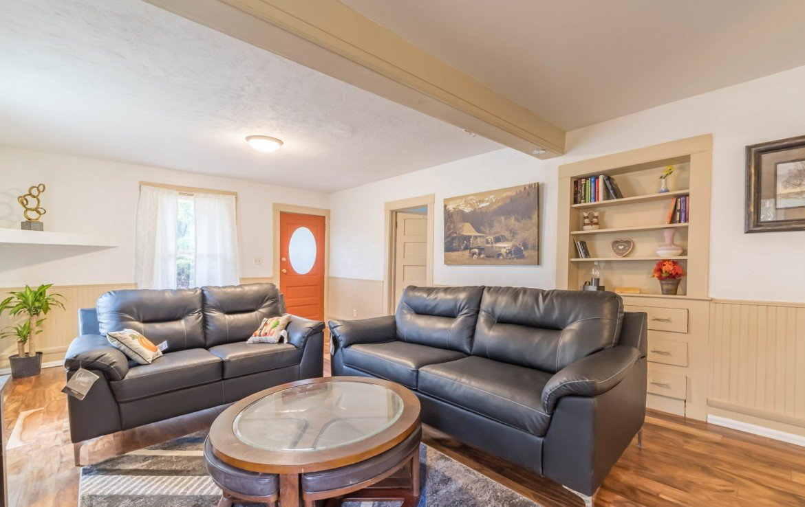 Living Room with Built In Storage - 1116 N 1st St Montrose, CO 81401 - Atha Team Real Estate Agents