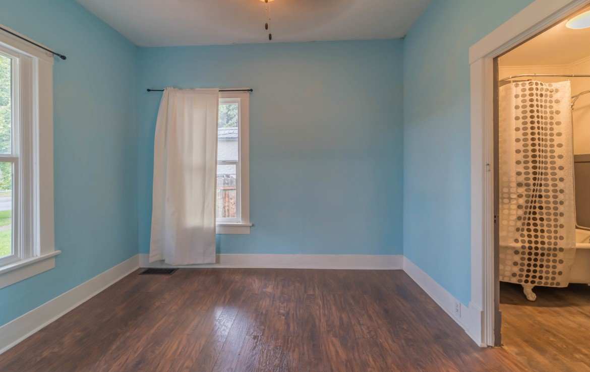 First Floor Bedroom with Ceiling Fan - 1116 N 1st St Montrose, CO 81401 - Atha Team Real Estate Agents