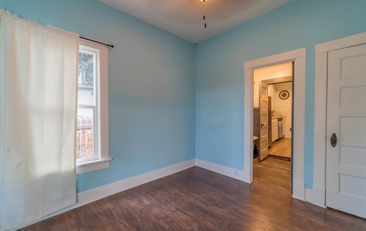 First Floor Bedroom with Window - 1116 N 1st St Montrose, CO 81401 - Atha Team Real Estate Agents