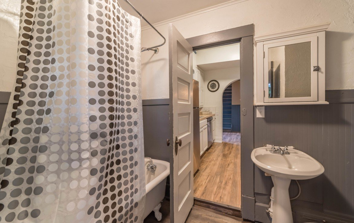 First Floor Bathroom with Claw Foot Tub - 1116 N 1st St Montrose, CO 81401 - Atha Team Real Estate Agents