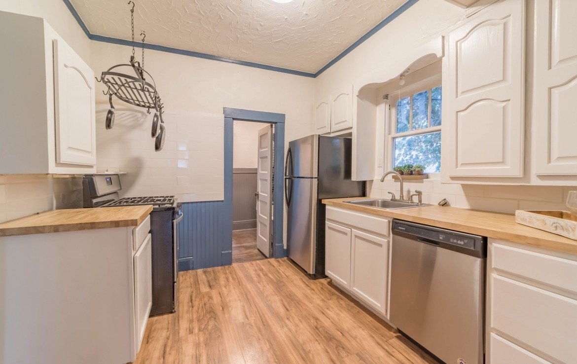 Kitchen with Stainless Steel Appliances - 1116 N 1st St Montrose, CO 81401 - Atha Team Real Estate Agents
