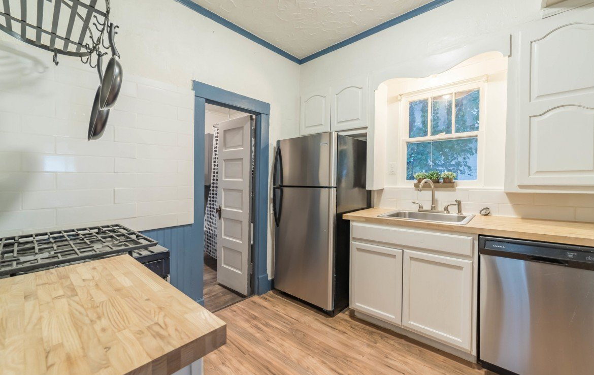 Kitchen with Connected Bathroom - 1116 N 1st St Montrose, CO 81401 - Atha Team Real Estate Agents