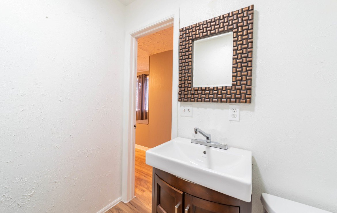 Half Bath with Vanity - 1116 N 1st St Montrose, CO 81401 - Atha Team Real Estate Agents
