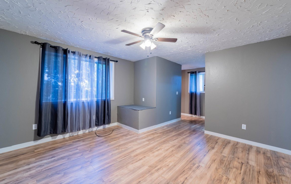 Family Room with Laminate Flooring - 1116 N 1st St Montrose, CO 81401 - Atha Team Real Estate Agents