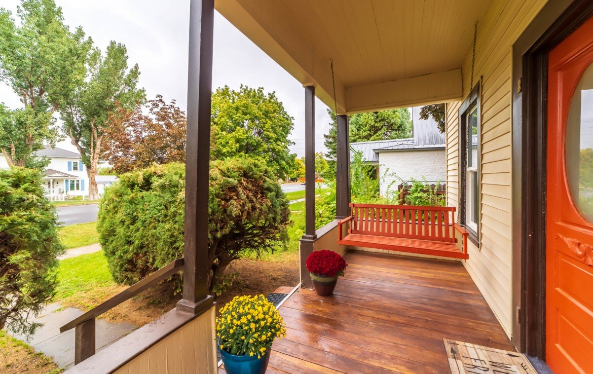 Covered Front Porch with Swing - 1116 N 1st St Montrose, CO 81401 - Atha Team Real Estate Agents