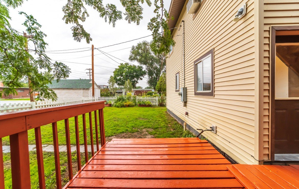 Back Deck with Fenced Yard - 1116 N 1st St Montrose, CO 81401 - Atha Team Real Estate Agents