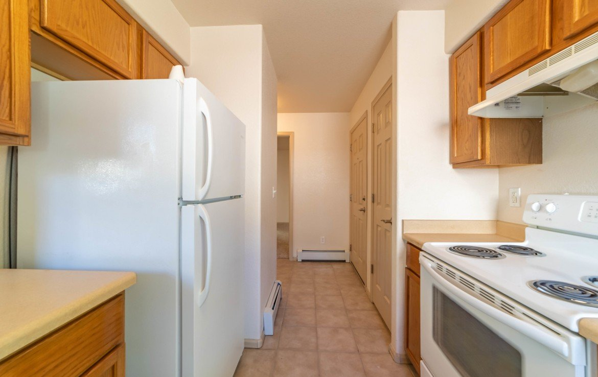 Kitchen to Laundry Room - 1314 Bighorn St Montrose, CO 81401 - Atha Team Residential Real Estate