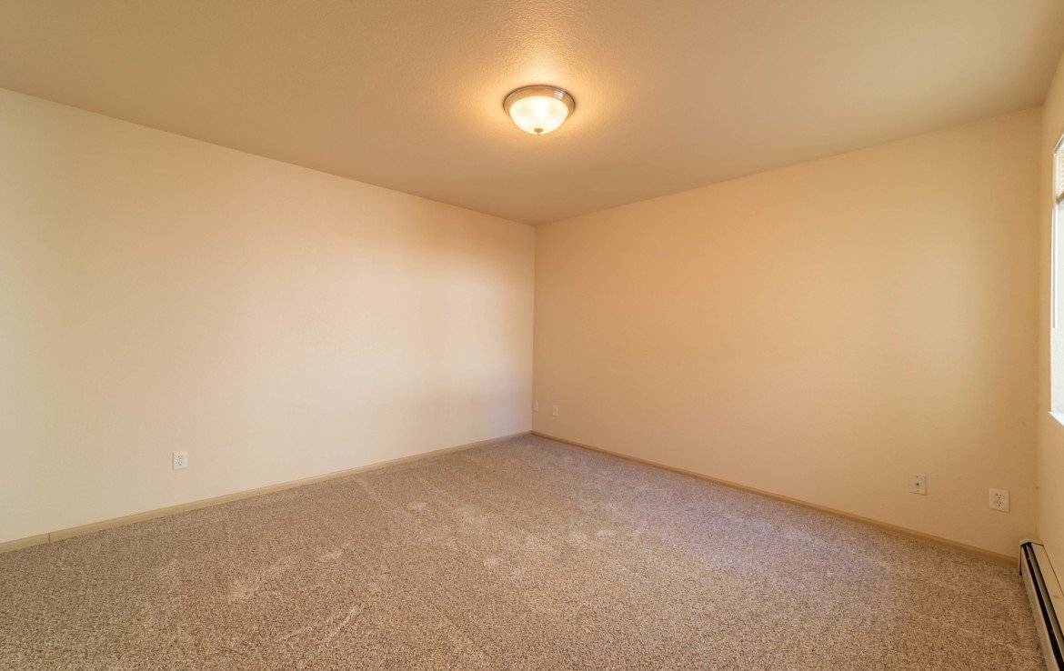 Master Bedroom with Hot Water Baseboard Heat - 1314 Bighorn St Montrose, CO 81401 - Atha Team Residential Real Estate