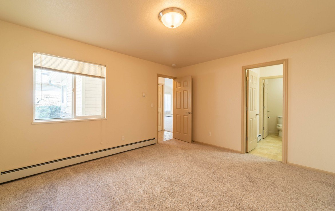 Master Bedroom and Bath - 1314 Bighorn St Montrose, CO 81401 - Atha Team Residential Real Estate