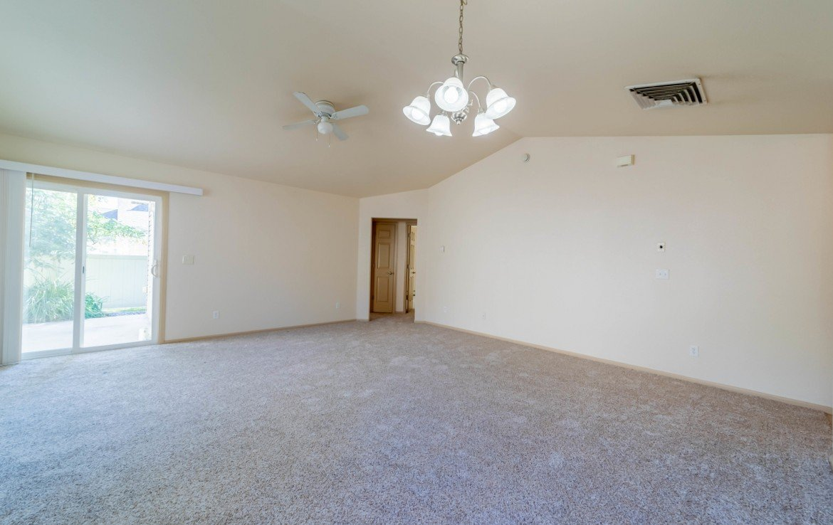 Living Room with Vaulted Ceilings - 1314 Bighorn St Montrose, CO 81401 - Atha Team Residential Real Estate