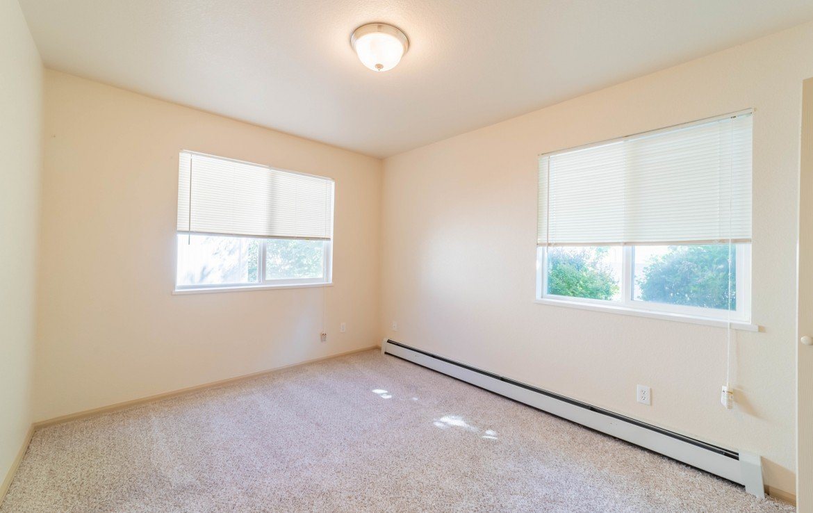 Guest Bedroom with Windows - 1314 Bighorn St Montrose, CO 81401 - Atha Team Residential Real Estate