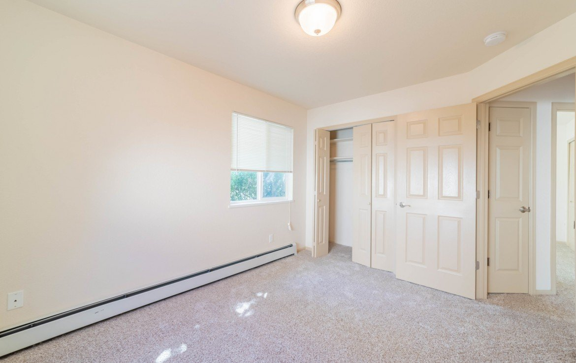 Guest Bedroom with Closet - 1314 Bighorn St Montrose, CO 81401 - Atha Team Residential Real Estate