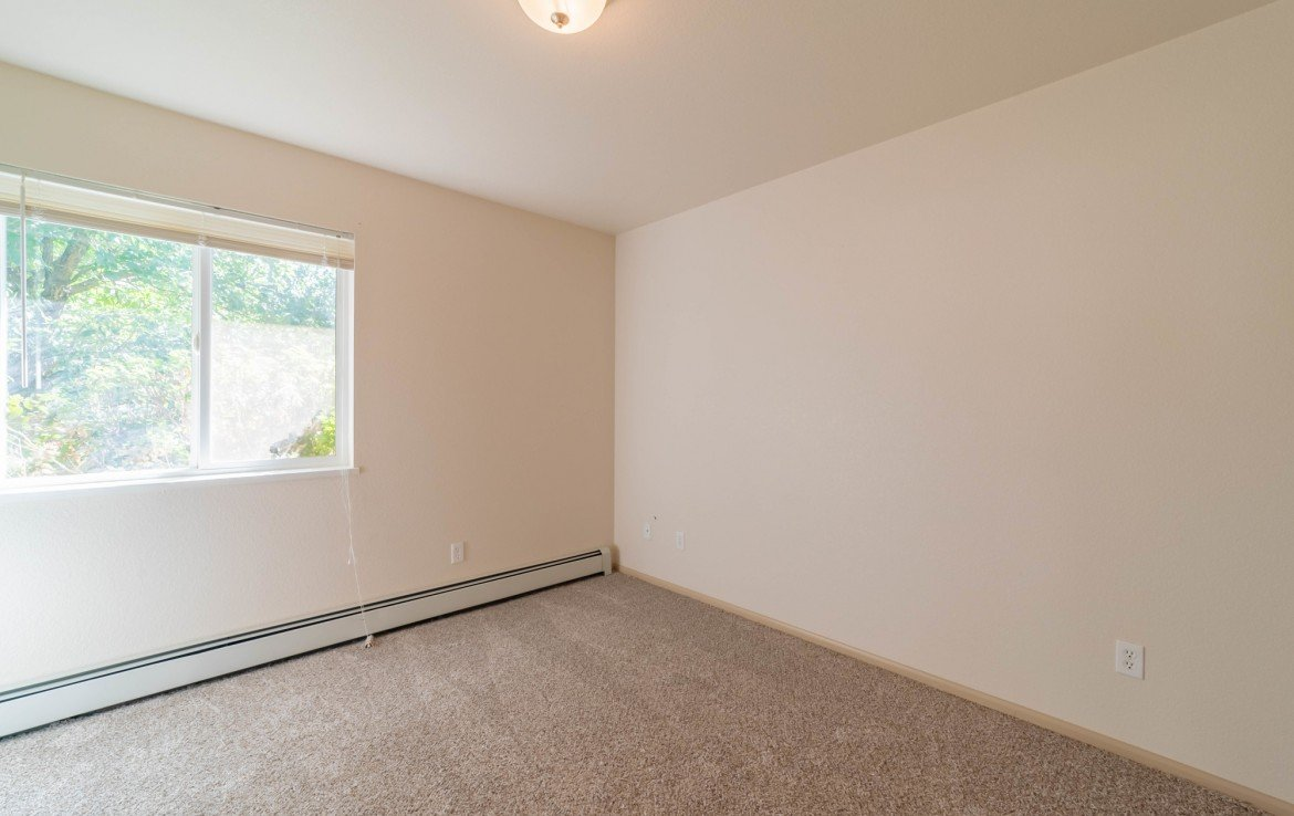 Third Bedroom with Baseboard Heat - 1314 Bighorn St Montrose, CO 81401 - Atha Team Residential Real Estate