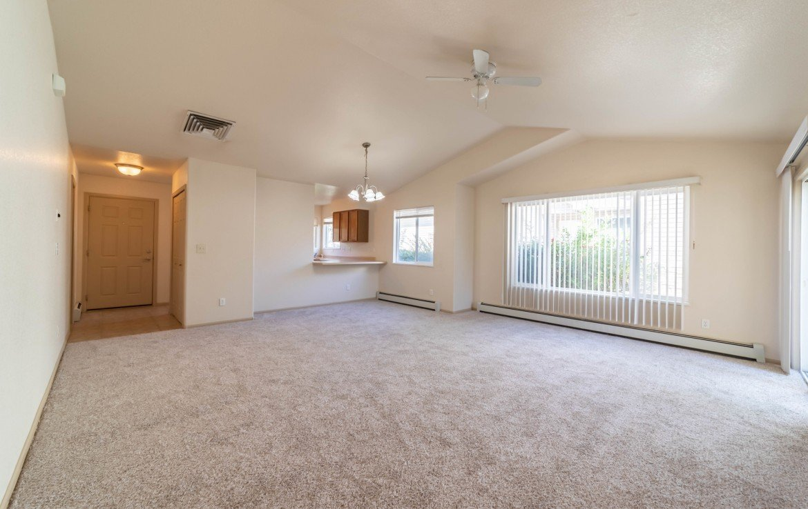 Living Room with Dining Area - 1314 Bighorn St Montrose, CO 81401 - Atha Team Residential Real Estate