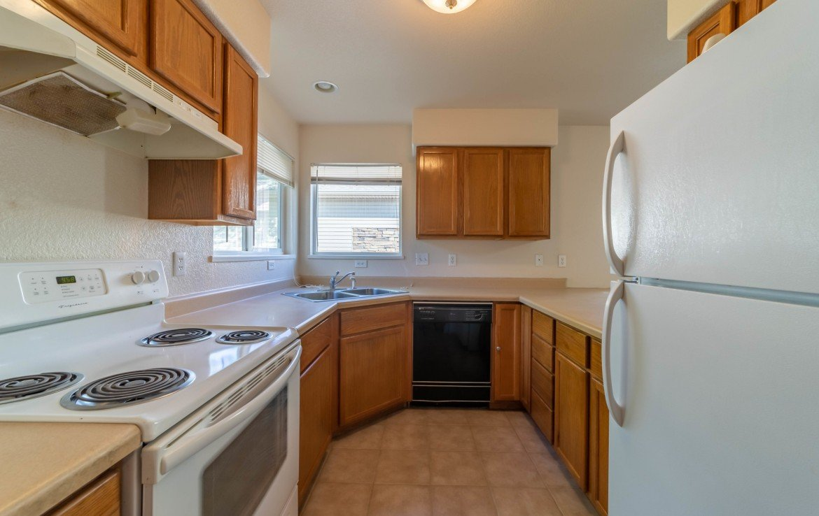Kitchen with Windows - 1314 Bighorn St Montrose, CO 81401 - Atha Team Residential Real Estate