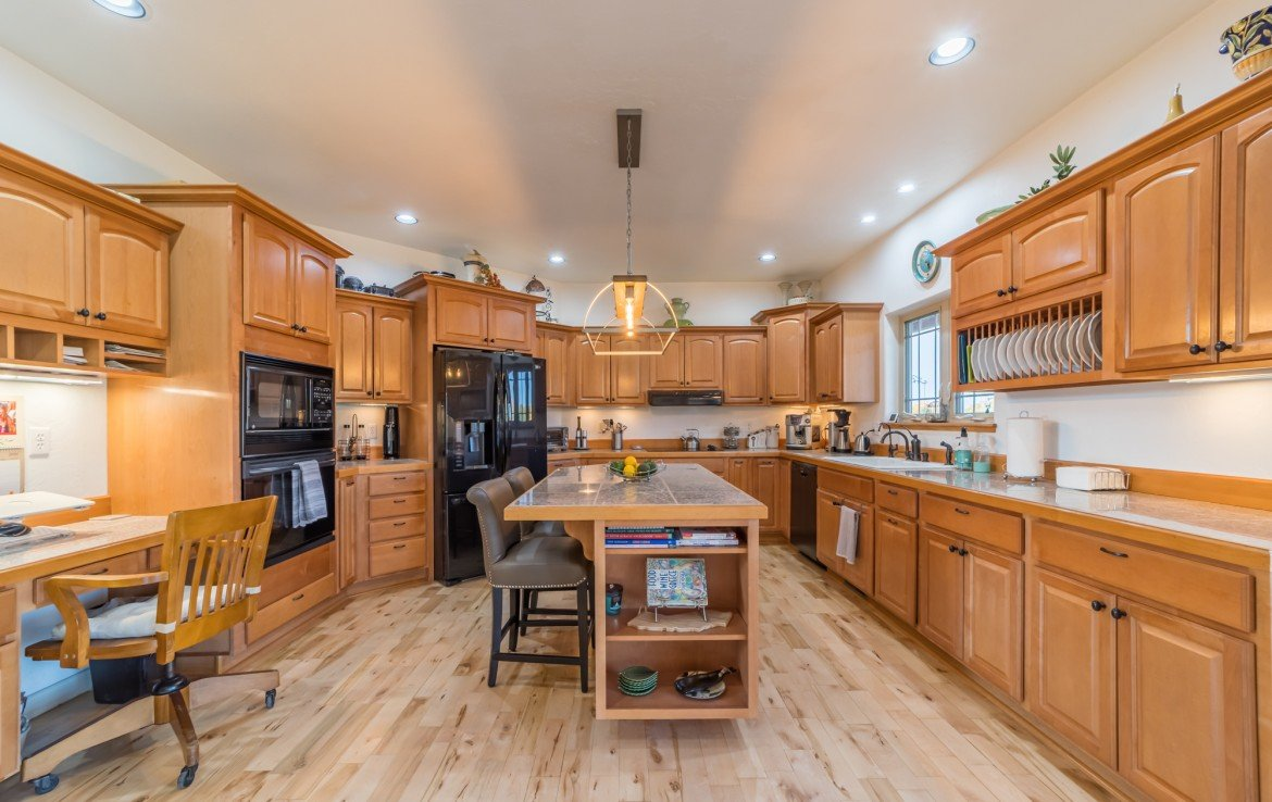 Kitchen with Center Island Seating - 3865 Grand Mesa Dr Montrose, CO 81403 - Atha Team Realty