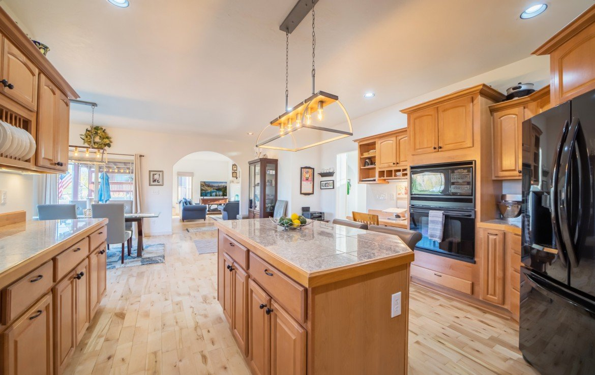 Kitchen with Double Wall Oven - 3865 Grand Mesa Dr Montrose, CO 81403 - Atha Team Realty