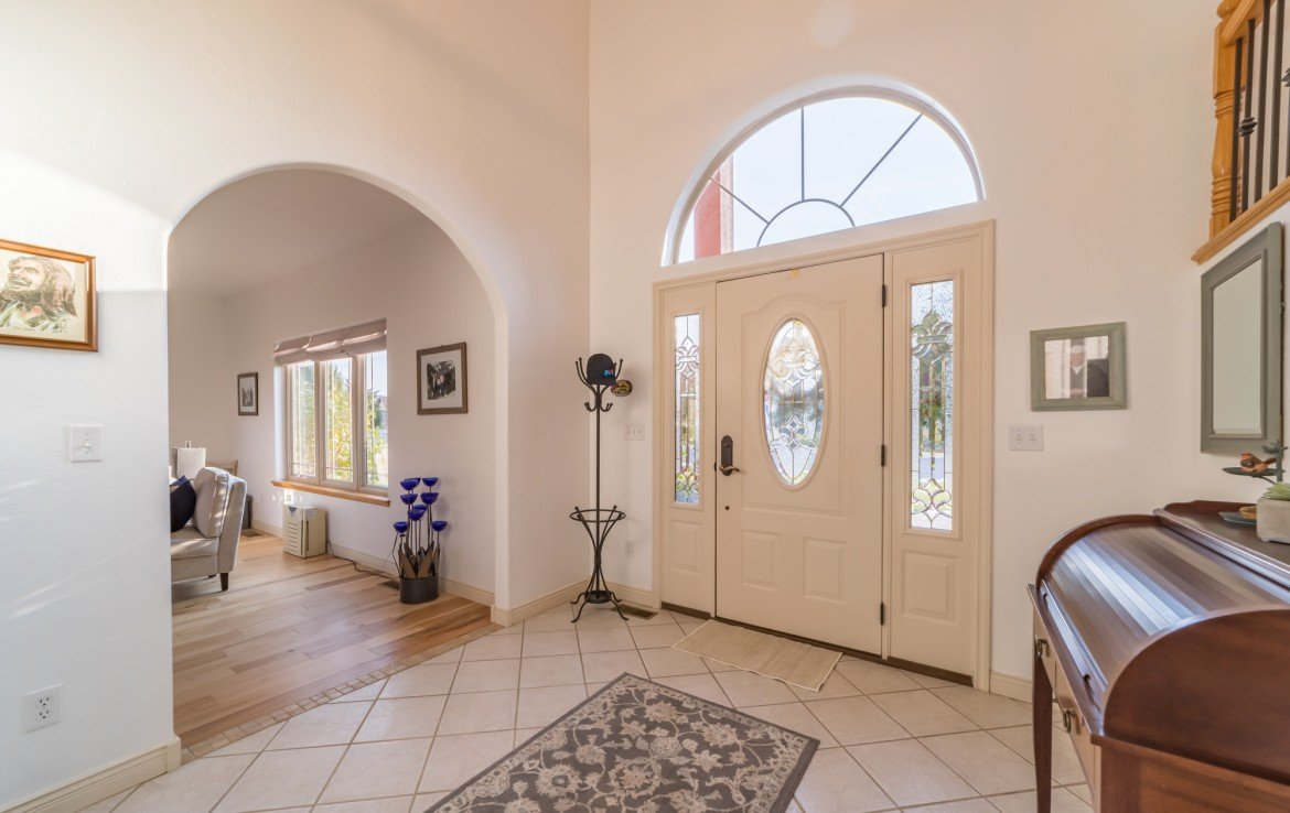 Tiled Flooring with Arched Transition to Living Room - 3865 Grand Mesa Dr Montrose, CO 81403 - Atha Team Realty