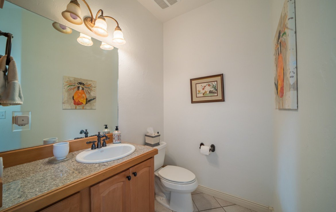 Tiled Half Guest Bathroom - 3865 Grand Mesa Dr Montrose, CO 81403 - Atha Team Realty