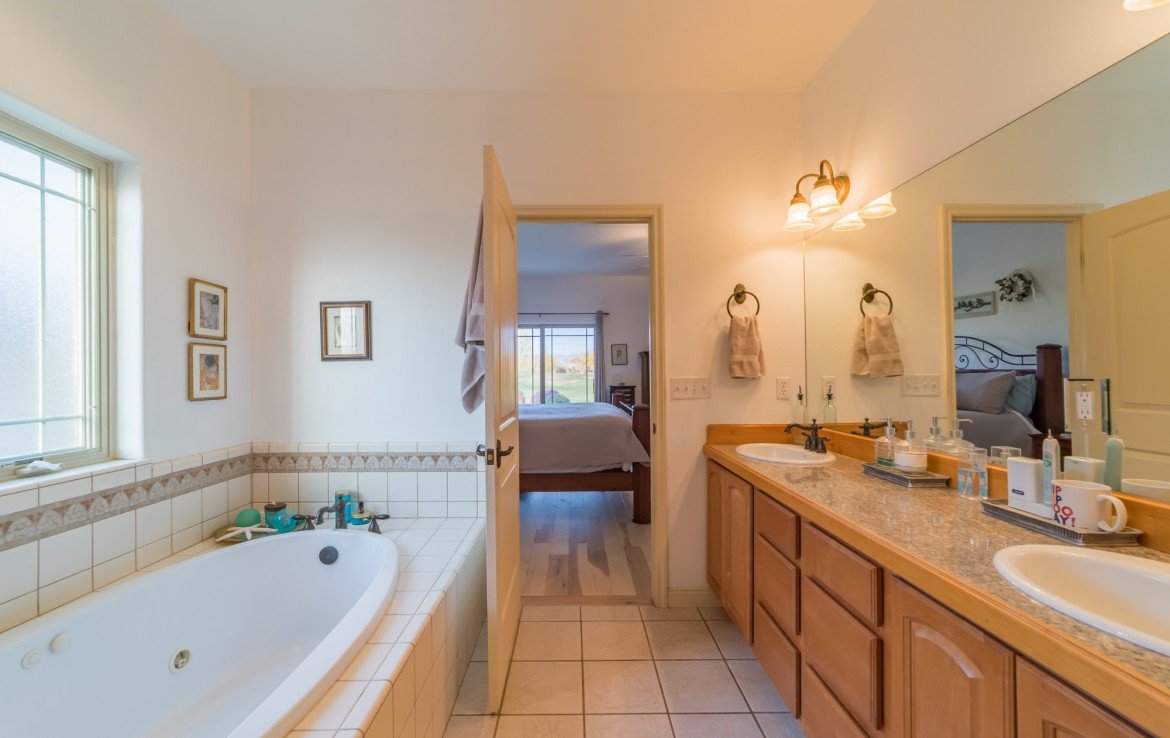 Master Bathroom with Jetted Tub - 3865 Grand Mesa Dr Montrose, CO 81403 - Atha Team Realty