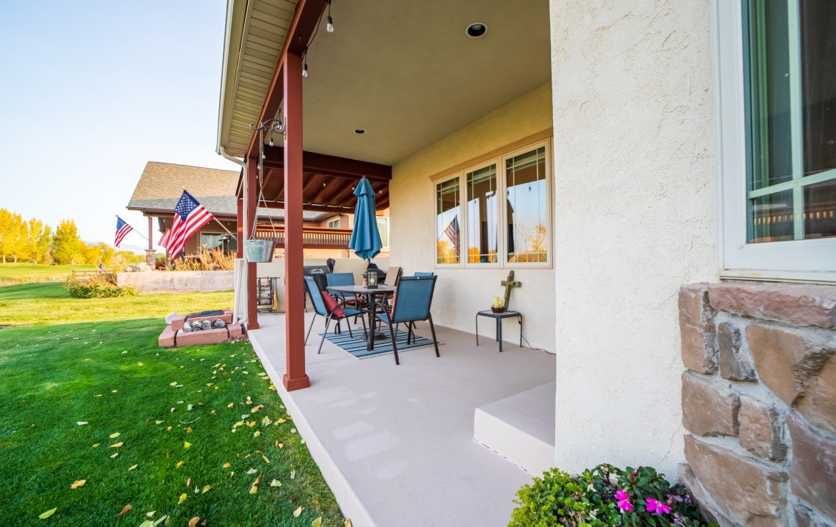 Covered Back Patio with Seating Area - 3865 Grand Mesa Dr Montrose, CO 81403 - Atha Team Realty