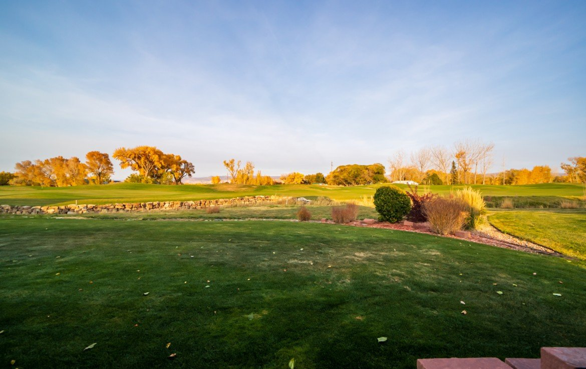 Back Yard Views to Hole 8 Golf Course - 3865 Grand Mesa Dr Montrose, CO 81403 - Atha Team Realty