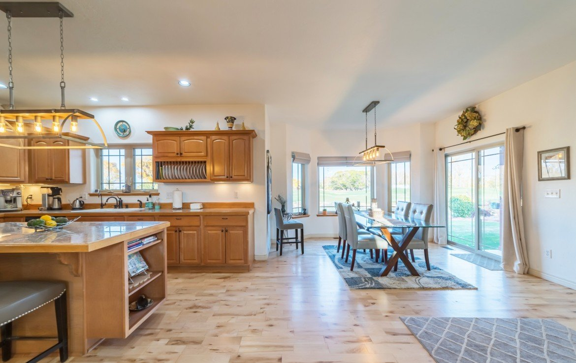 Kitchen and Dining with Hardwood Flooring - 3865 Grand Mesa Dr Montrose, CO 81403 - Atha Team Realty