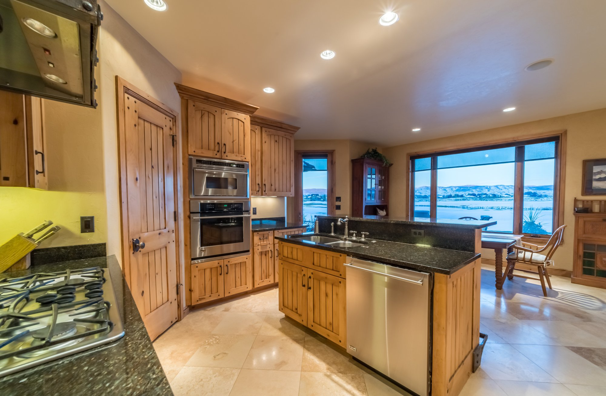 Chef's Kitchen with Stainless Appliances - 2839 Sleeping Bear Rd Montrose, CO 81401 - Atha Team Luxury Real Estate