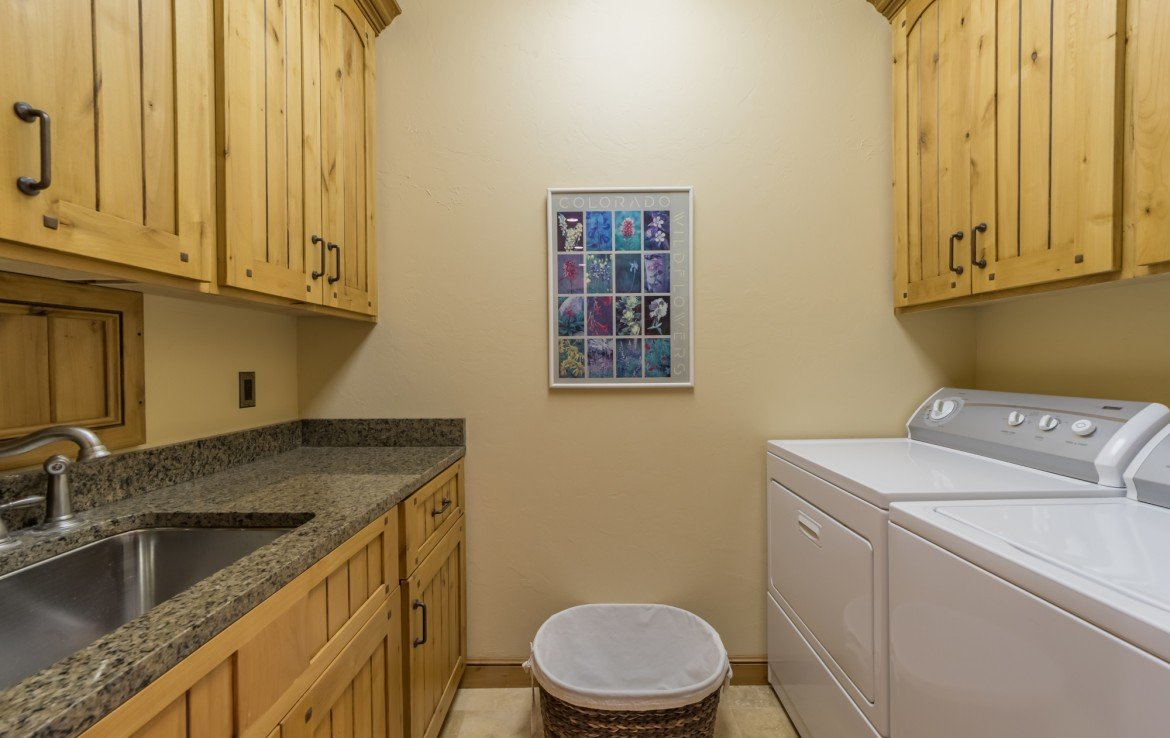 Laundry Room with Utility Sink - 2839 Sleeping Bear Rd Montrose, CO 81401 - Atha Team Luxury Real Estate