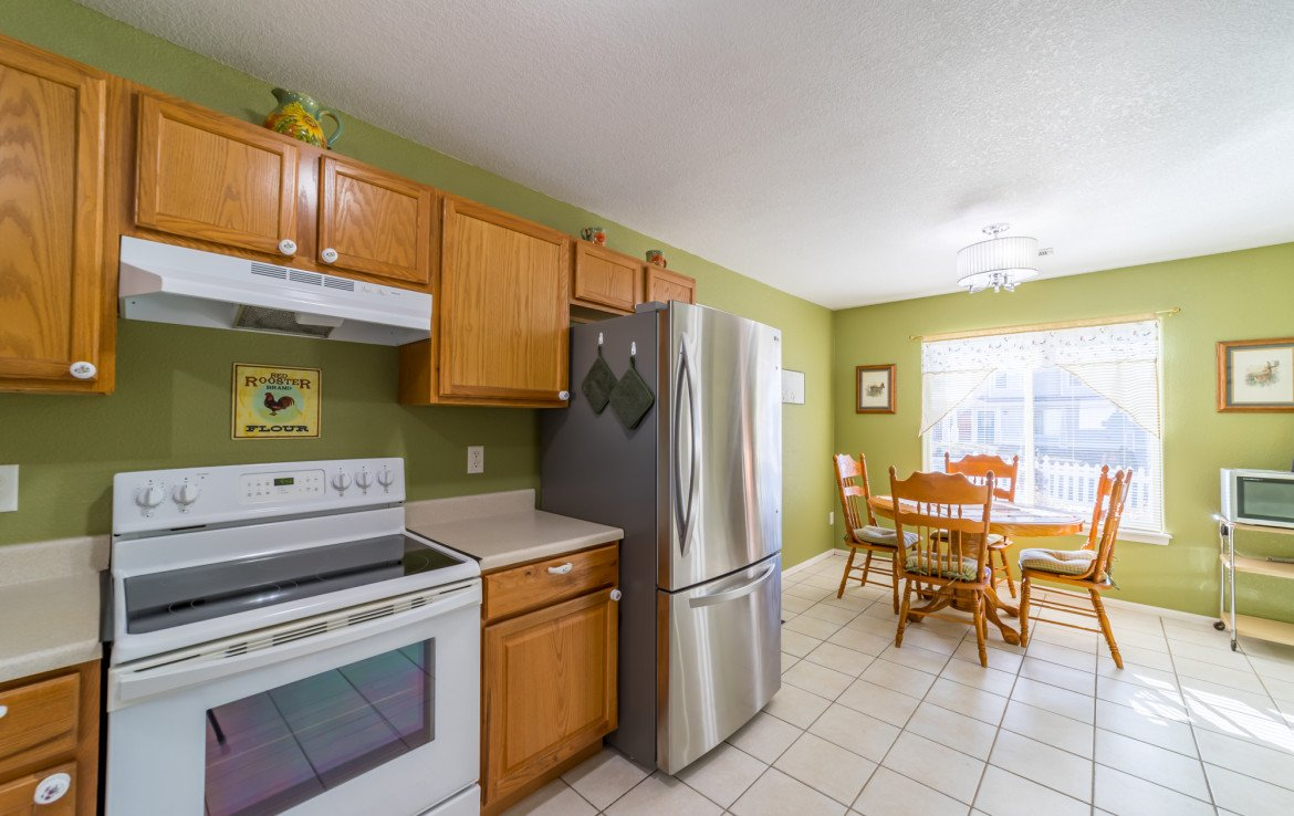 Kitchen with Dining Area - 1732 Pioneer Circle Delta, CO 81416 - Atha Team Real Estate